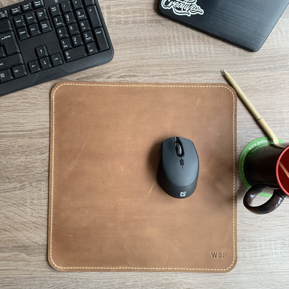 Leather mouse pad with firmware