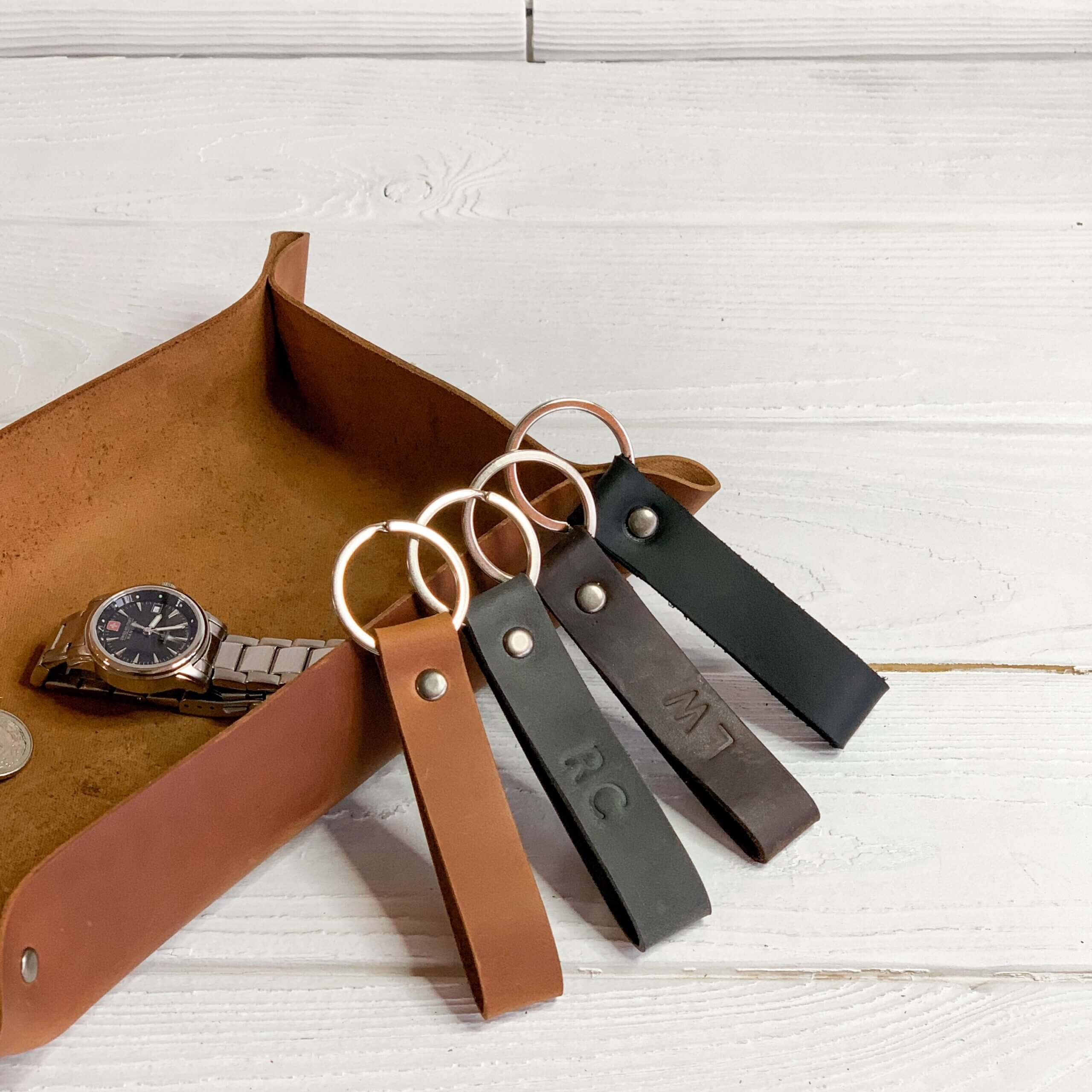 Four embossed leather keychains