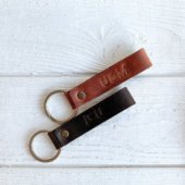 Two leather embossed keychains